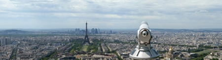 Telescope viewer and city skyline at daytime. Paris, France. Taken from the tour Montparnasse with the Eiffel Tower, Le Grande Palais, Les Halles, St. Eustace & La Defense clearly visible photo