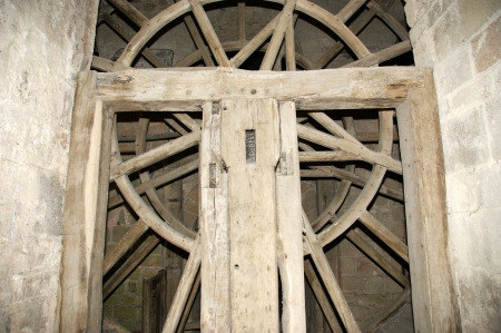 Wooden gear wheel in old windmill photo