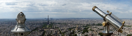 Telescope viewer and city skyline at daytime. Paris, France. Taken from the tour Montparnasse photo