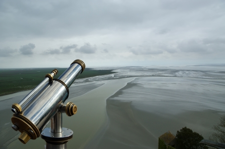 Telescope viewer and  View from Mont Saint-Michel, Normandy, France--one of the most visited tourist sites in France Stock Photo - 17089081