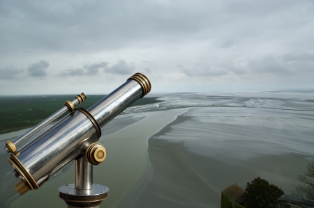 Telescope viewer and  View from Mont Saint-Michel, Normandy, France--one of the most visited tourist sites in France Stock Photo - 17089133