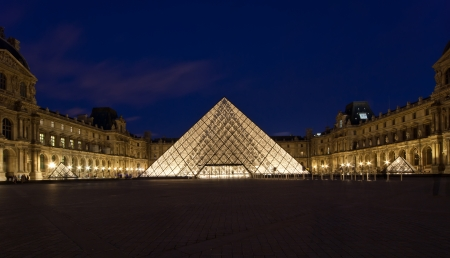 Louvre Pyramid at dusk, Paris, France. The Louvre is the biggest Museum in Paris displayed over 60,000 square meters of exhibition space