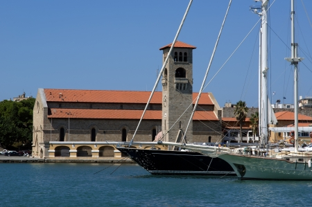 Rhodes island landmark, Mandraki Port, Greece. The historical port is still used today as a marina by small yachts and ferries photo