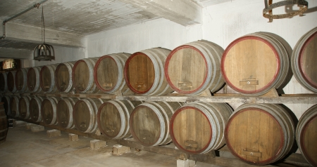 matures: Oak barrels in which the wine matures at a winery Stock Photo