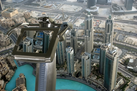 Telescope viewer and Aerial view from the height of Burj Khalifa. Dubai, UAE