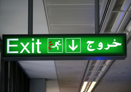 Emergency exit sign in English and Arabic languages Stock Photo - 20394556