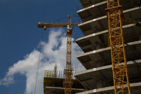 Cranes on a construction site. Industrial image photo