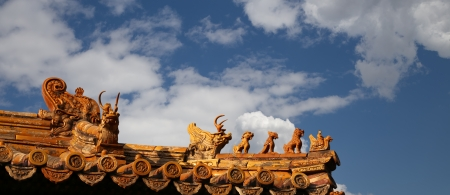 dalai: Roof decorations in Yonghe Temple (Lama Temple) in Beijing, China Stock Photo