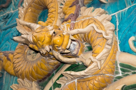 Dragon sculpture. The Nine-Dragon Wall (Jiulongbi) at Beihai park, Beijing, China. The wall was built in 1756 CE photo