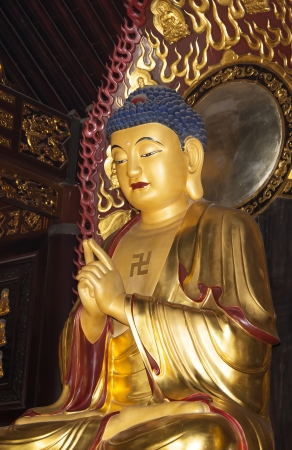 Buddhist Temple. Golden statue of Buddha-- southern Xian (Sian, Xian), Shaanxi province, China photo
