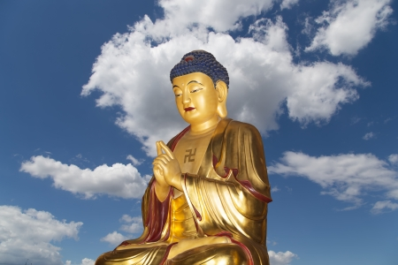 Buddhist Temple. Golden statue of Buddha-- southern Xian (Sian, Xian), Shaanxi province, China photo