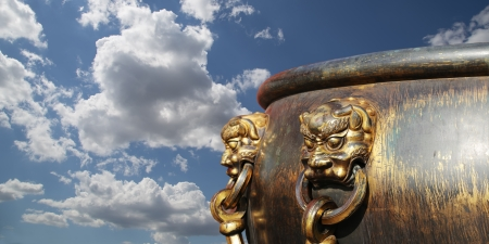 bronze bowl: Large bronze bowl to extinguish fire with image Chinese dragon statue in the Forbidden City. Beijing, China