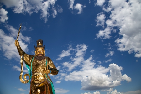 Dharmapala (protector of dharma), Buddhist temple in Beijing, China.  Dharmapala is a type of wrathful deity. The name means Dharma-defender in Sanskrit, also known as the Defenders of the Law (Dharma), or the Protectors of the Law Stock Photo - 24616589
