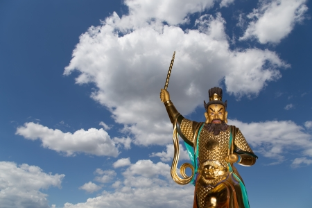 Dharmapala (protector of dharma), Buddhist temple in Beijing, China.  Dharmapala is a type of wrathful deity. The name means Dharma-defender in Sanskrit, also known as the Defenders of the Law (Dharma), or the Protectors of the Law Stock Photo - 24616590