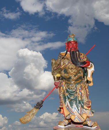 Dharmapala (protector of dharma), Buddhist temple in Beijing, China.  Dharmapala is a type of wrathful deity. The name means Dharma-defender in Sanskrit, also known as the Defenders of the Law (Dharma), or the Protectors of the Law Stock Photo - 24772047
