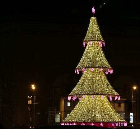 Christmas tree illuminated to Christmas and New Year holidays at night in Moscow, Russia photo