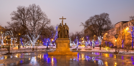 Saints Cyril and Methodius monument and trees illuminated to Christmas and New Year holidays at night in Moscow, Russia.   photo