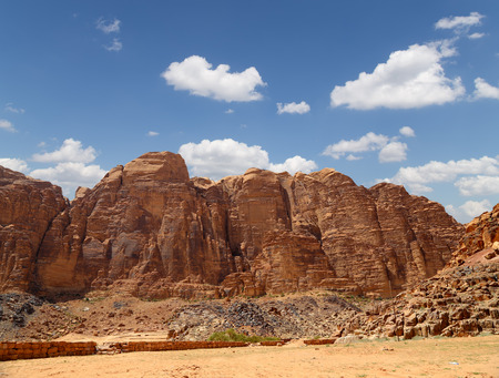 Mountains of Wadi Rum Desert also known as The Valley of the Moon is a valley cut into the sandstone and granite rock in southern Jordan 60 km to the east of Aqaba photo