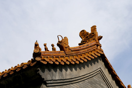 sutra: Traditional decoration of the roof of a Buddhist temple, Beijing, China Stock Photo