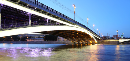 moskva river: Bolshoy Ustinsky Bridge in Moscow, Russia-- is a steel arch bridge that spans Moskva River near the mouth of Yauza River, connecting the Boulevard Ring with Zamoskvorechye district