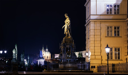 Night view of statue on the Charles Bridge in Prague, Czech Republic