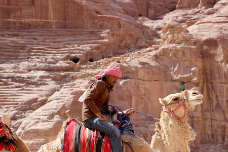 bedouin: Bedouin on a camel in Petra,  Jordan