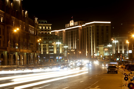 duma: Traffic of cars in Moscow city center (Teatralny Proezd near the Building of The State Duma of the Federal Assembly of Russian Federation), Russia Stock Photo
