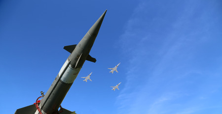 conflict: Modern Russian anti-aircraft missiles and military aircrafts fly in formation against the sky Stock Photo
