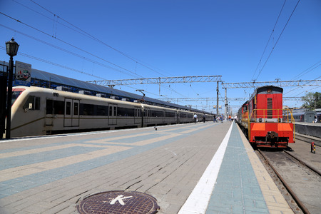 Train on Moscow passenger platform (Yaroslavsky railway station), Russia-- is one of nine main railway stations in Moscow, situated on Komsomolskaya Square. It has highest passenger throughput of all nine Moscow stations