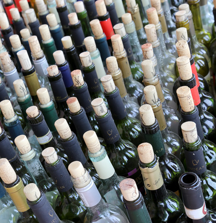 stacked up: very much stacked up wine bottles  with  corks Editorial