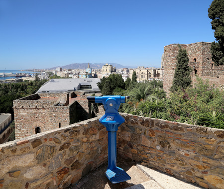 viewer: Telescope viewer overlooking the Alcazaba castle on Gibralfaro mountain. Malaga, Andalusia, Spain. The place is declared UNESCO World Heritage Site
