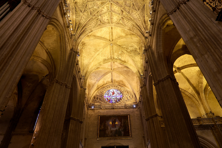 church bells: Interior Cathedral of Seville -- Cathedral of Saint Mary of the See, Andalusia, Spain -- is the third largest church in the world and at it time of completion in the 1500 it was the world  largest. Burial Place of Christopher Columbus Editorial