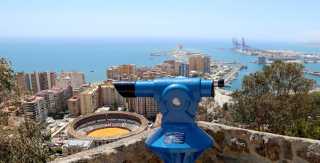 toros: Telescope viewer overlooking the Malaga with the Plaza de Toros (bullring) from the aerial view, Spain
