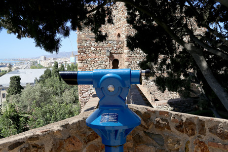 declared: Telescope viewer overlooking the Alcazaba castle on Gibralfaro mountain. Malaga, Andalusia, Spain. The place is declared UNESCO World Heritage Site