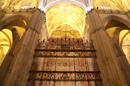 IGLESIA: Interior Cathedral of Seville -- Cathedral of Saint Mary of the See, Andalusia, Spain -- is the third largest church in the world and at it time of completion in the 1500 it was the world  largest. Burial Place of Christopher Columbus Editorial