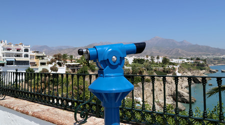 viewer: Telescope viewer overlooking from Balcon de Europa in Nerja, Andalusia, Spain. It is on the country southern Mediterranean coast, about 50 km east of Malaga