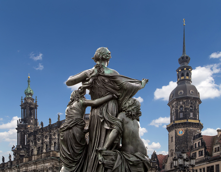 Sculpture on the Bruhl Terrace and  Hofkirche or Cathedral of Holy Trinity - baroque church in Dresden, Sachsen, Germany Stock Photo