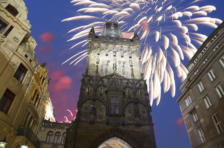 back gate: Powder tower (gate) at evening and holiday fireworks in Prague, Czech Republic. It is one of the original city gates, dating back to the 11th century. It is one of the symbols of Prague leading into the Old Town. Editorial