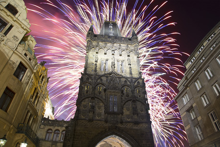 11th century: Powder tower (gate) at evening and holiday fireworks in Prague, Czech Republic. It is one of the original city gates, dating back to the 11th century. It is one of the symbols of Prague leading into the Old Town. Editorial