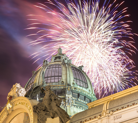 View on Municipal House (1912) in art nouveau style and holiday fireworks -- is a major landmark and concert hall in Prague, Czech Republic