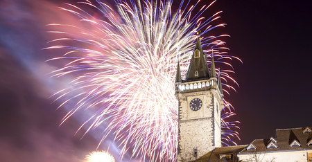 Old Town City Hall in Prague (Night view) and holiday fireworks, view from Old Town Square, Czech Republic