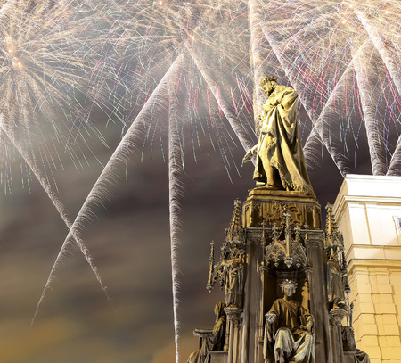 iv: Bronze Statue of Charles IV and holiday fireworks in Prague, Czech Republic (Night view)