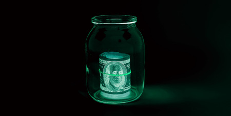 One hundred dollar bills (banknotes )  close up, U.S. currency-- in UV light protection