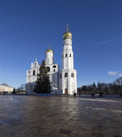 Ivan the Great Bell-Tower complex with New Year (Christmas)  tree. Cathedral Square, Inside of Moscow Kremlin, Russia. UNESCO World Heritage Site