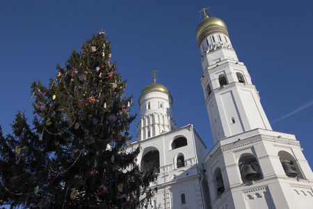 eclecticism: Ivan the Great Bell-Tower complex with New Year (Christmas)  tree. Cathedral Square, Inside of Moscow Kremlin, Russia. UNESCO World Heritage Site