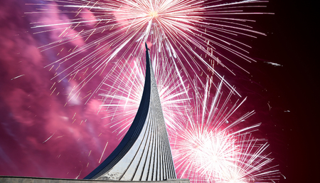 Conquerors of Space Monument in the park outdoors of Cosmonautics museum and fireworks, near VDNK exhibition center, Moscow, Russia