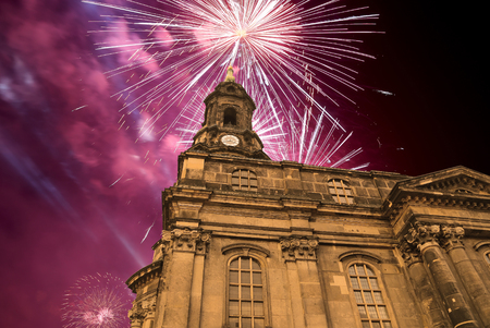 dresden: Hofkirche or Cathedral of Holy Trinity and holiday fireworks - baroque church in Dresden, Sachsen, Germany