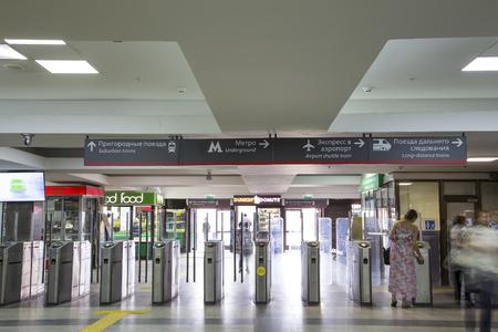 Modern metallic turnstile gate, entrance of railway station (Paveletsky railway terminal). Moscow, Russia