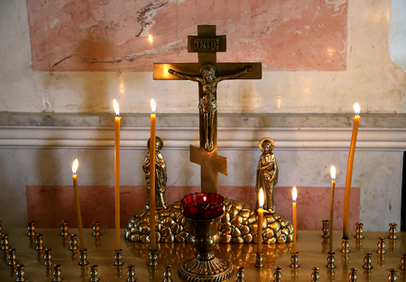 easter candle is burning: The candle flame in orthodox church, selective focus, closeup Stock Photo
