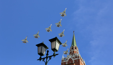 Russian military aircrafts fly in formation over Moscow( Tower of Moscow Kremlin) during Victory Day parade, Russia
